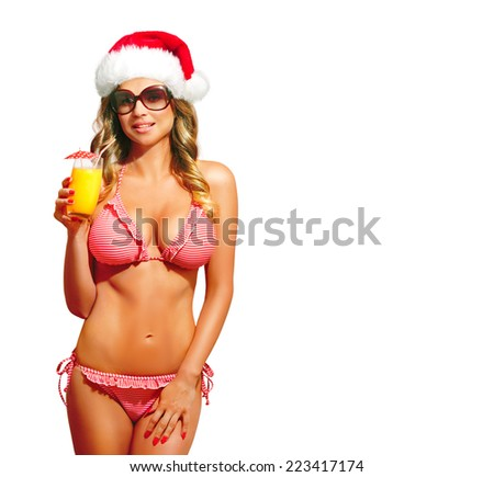 Bikini, fitness model with Santa Hat, sunglasses and cocktail. Happy beautiful woman with suntan, smiling. Christmas card. Isolated, over white background, with copy space.  - stock photo