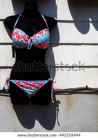 Bikini swimsuit on a black mannequin ready for summer beach wear. - stock photo