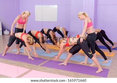 Bikram Hot Yoga Class instructor with students - stock photo