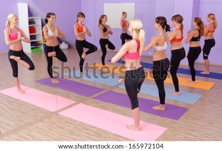Bikram Hot Yoga class is in session   - stock photo
