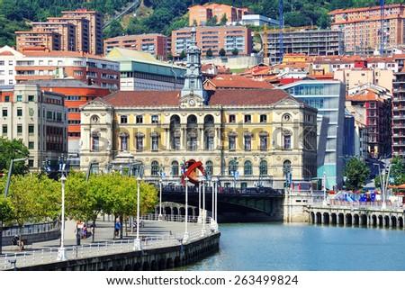 Bilbao city downtown with a Nevion River, Bridge and promenade - stock photo