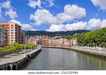 Bilbao Cityscape - Photo taken from the Zubizuri Bridge - stock photo