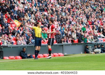 BILBAO, SPAIN - ARPIL 3: Oscar de Marcos and Alonso Fernandez, soccer referee, in the match between Athletic Bilbao and Granada, celebrated on April 3, 2016 in Bilbao, Spain
