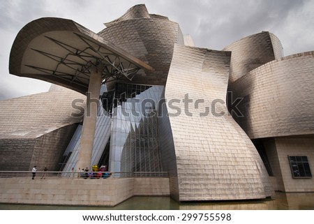 BILBAO, SPAIN - AUGUST 13: Entrance of Guggenheim Museum on August 13, 2014 in Bilbao, Spain. The building is clad in glass, titanium and limestone.