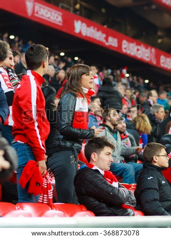 BILBAO, SPAIN - JANUARY 20: Beautiful girl fan during the quarter-finals of the Cup match between Athletic Club Bilbao, celebrated on January 20, 2016, in Bilbao, Spain - stock photo