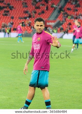 BILBAO, SPAIN - JANUARY 20: Dani Alves greets fans at the preheating in the quarter-finals of the Cup between Athletic Club Bilbao, final score 1-2, celebrated on January 20, 2016, in Bilbao, Spain - stock photo