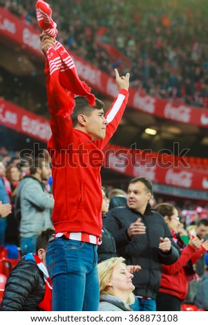 BILBAO, SPAIN - JANUARY 20: Unidentified Athletic Club Bilbao fans during the quarter-finals of the Cup match between Athletic Club Bilbao, celebrated on January 20, 2016, in Bilbao, Spain - stock photo