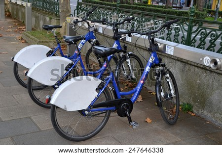 BILBAO, SPAIN - OCTOBER 11: Some bicycles of the bike rental service in Bilbao, Spain on October 11, 2014. Bilbon Bizi is a bike sharing service that people can rent bicycles for short trips. - stock photo
