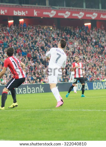 BILBAO, SPAIN - SEPTEMBER 23: Cristiano Ronaldo is preparing to shoot a ball in front of one opposing player in the San Mames Stadium, on September 23, 2015 in Bilbao, Spain - stock photo