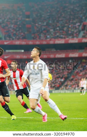 BILBAO, SPAIN - SEPTEMBER 23: Cristiano Ronaldo is preparing to shoot a ball in front of two opposing players in the San Mames Stadium, on September 23, 2015 in Bilbao, Spain - stock photo