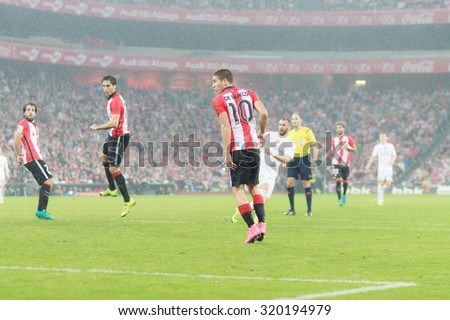 BILBAO, SPAIN - SEPTEMBER 23: Karim Benzema shot to goal while Oscar de Marcos, Beaat Etxebarria and Xabier Etxeita observed in the San Mames Stadium, on September 23, 2015 in Bilbao, Spain