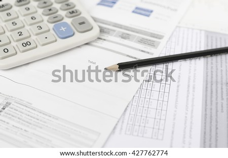 Bill and calculator with pencil, Bill of finance, Bill of electricity, Bill for medical, Macro paper bill, Bill for income and expenditure,  Pencil with calculator on finance bill selective focus - stock photo