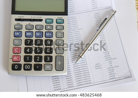 Bill and calculator with pencil ,Bill of finance,Bill of electricity,Bill for medical , Macro peper bill, Bill for income and expenditure , Pencil with calculator on finance bill selective focus