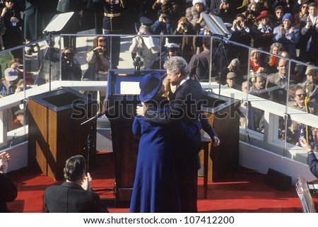 Bill Clinton, 42nd President, embraces wife Hillary Clinton and daughter Chelsea on Inauguration Day 1993, Washington, DC - stock photo