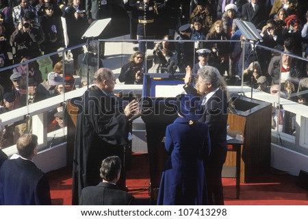 Bill Clinton, 42nd President, takes the Oath of Office on Inauguration Day from Chief Justice William Rehnquist on January 20, 1993 in Washington, DC - stock photo