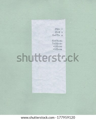 bill or receipt isolated over light green paper background - stock photo