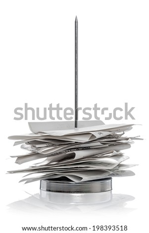 Bill / receipt spike isolated on a white background. - stock photo