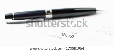 Bill to back with black pen - stock photo