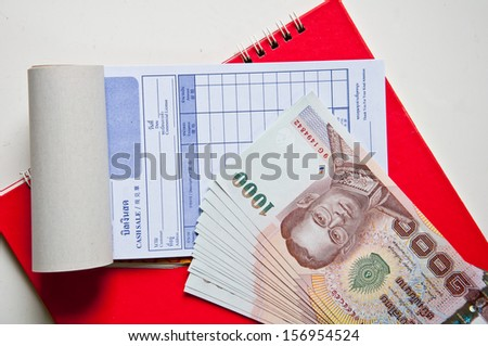 Bill with money on notebook isolated on a white background.  - stock photo