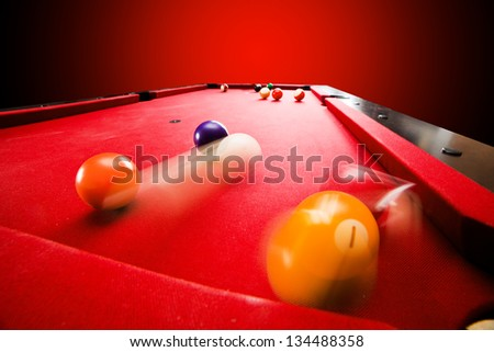 Billards pool game. Breaking the color ball from triangle. Red cloth table - stock photo