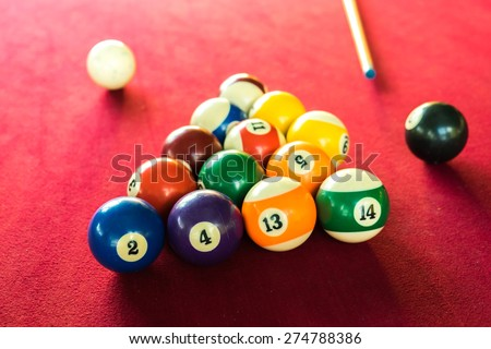 Billards Pool Game. Color Balls In Triangle, Aiming At Cue Ball. Red Cloth