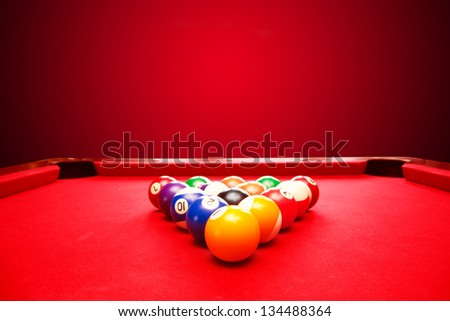Billards pool game. Color balls in triangle. Red cloth table - stock photo