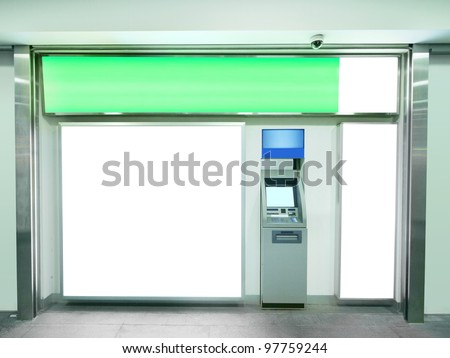 Billboard and automated teller machine - stock photo