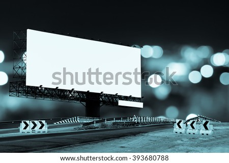billboard and bridge with bokeh light in city night time background