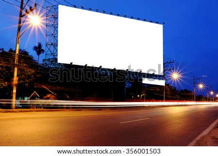 billboard at night time with blur and flare from street light