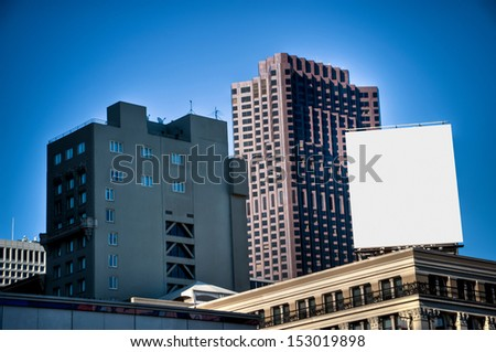 Billboard between skyscrapers - stock photo