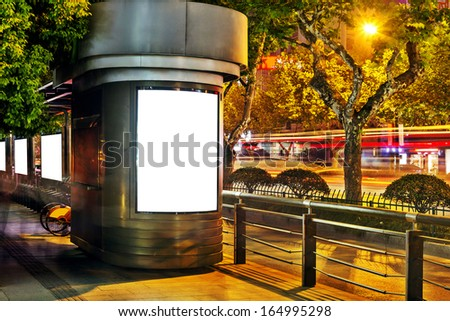 billboard in the station at night - stock photo