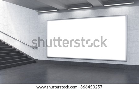 billboard in the underground, stairs up to the left. Grey walls. Concept of underground advertising. 3D rendering