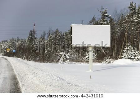 billboard on the snowy roadside  - stock photo
