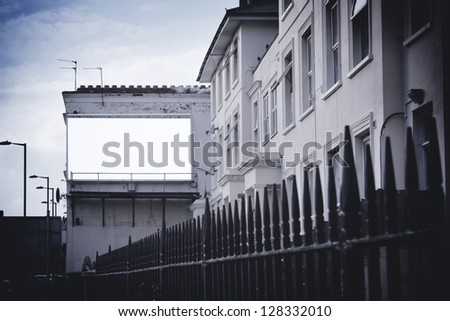 Billboard on wall at end of street - stock photo