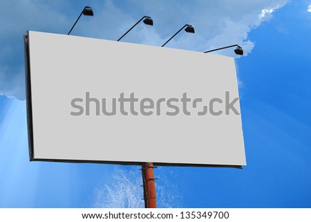 billboard with a total of four lights with blue clouds background - stock photo