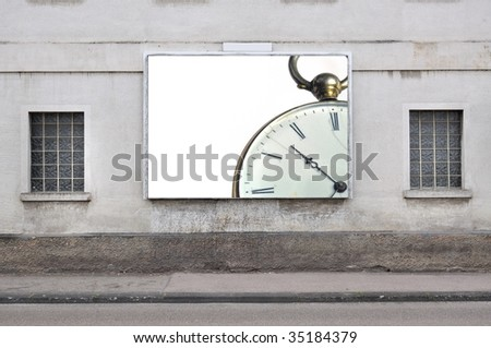 billboard with a vintage pocket watch - stock photo