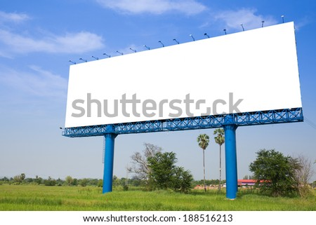 Billboard with empty screen, against blue cloudy sky.