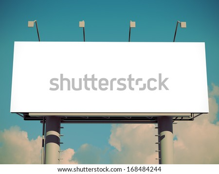 Billboard with empty screen, against blue sky with retro effect    - stock photo