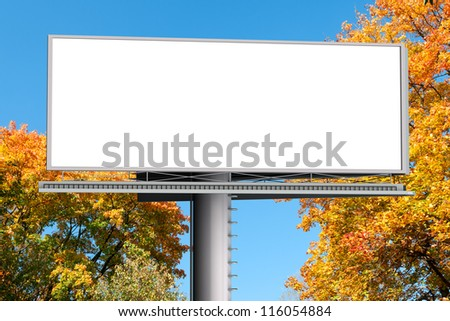 Billboard with empty screen, against red autumn tree - stock photo