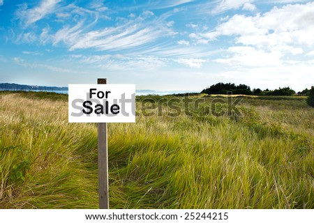 Billboard with the word For Sale in a beautiful landscape