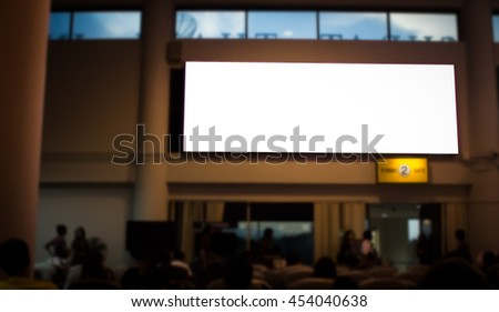Billboards in airports over Silhouette blur of passengers waiting to board the plane at the airport. Billboards display ad business concept.Select focus - stock photo