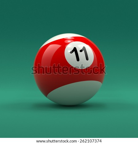 Billiard ball number 11 striped white and red color on green table background - stock photo