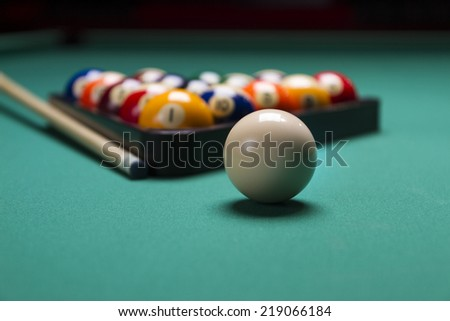 Billiard balls arranged in a triangle;selective focus on white ball;shallow focus; - stock photo