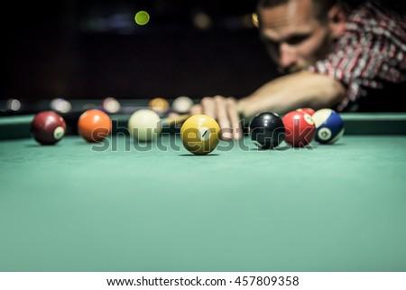 Billiard balls in a green pool table. - stock photo