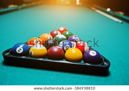 Billiard balls in a pool table at triangle - stock photo
