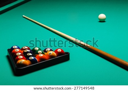 Billiard balls in a pool table, closeup - stock photo