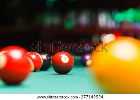 Billiard balls in a pool table, closeup - stock photo