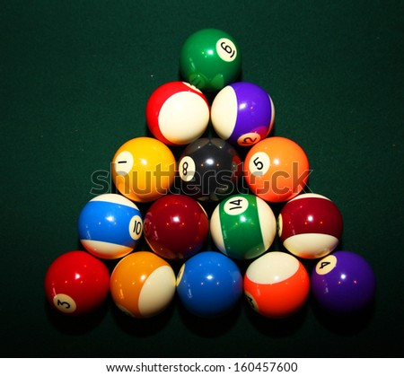 billiard balls on a green pool table