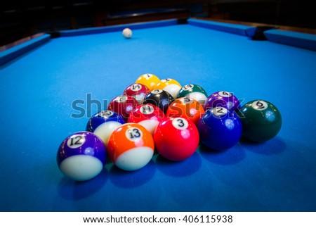 billiard balls on blue billiard table - stock photo