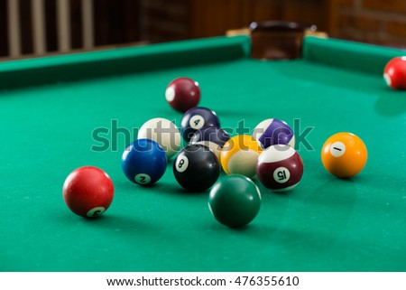 Billiard balls on green table with billiard cue, Snooker, Pool game, shallow depth of field